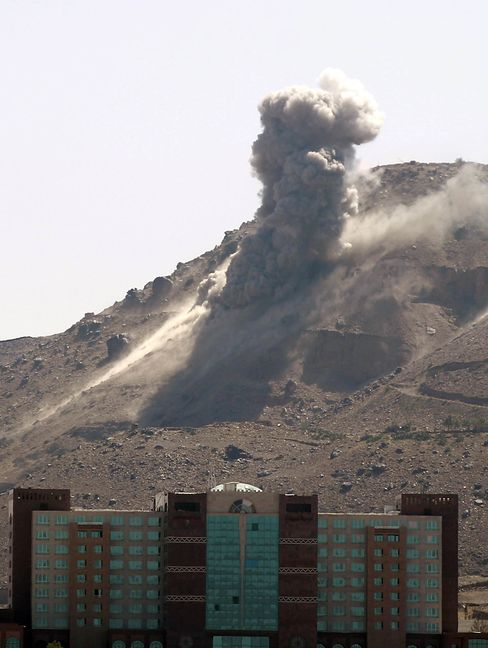 Smoke billows following an air-strike by the Saudi-led coalition targeting an arms depot on the Nuqom mountain in Yemen.