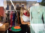 A worker dresses a mannequin at a store in Mobile, Alabama.