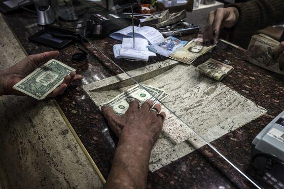 In Venezuela Bond Market, Gunmen and Bags of Cash Are Required