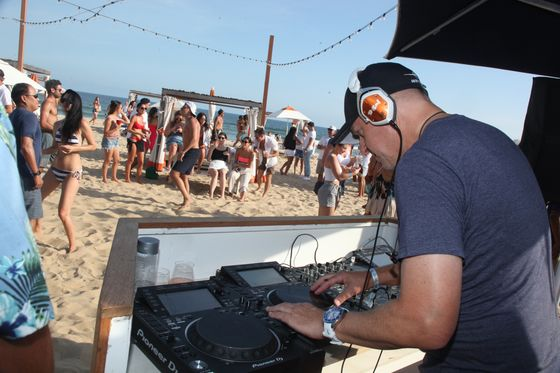 What It's Like at a Beach Party Where Goldman's David Solomon Is the DJ