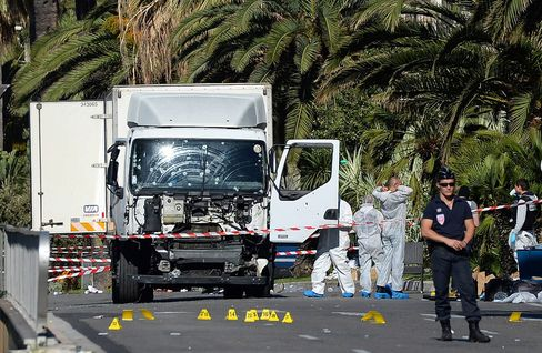 Police secure the area around the truck in Nice on July 15.