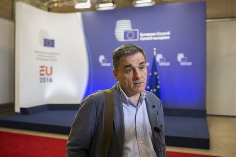 Euclid Tsakalotos leaves the Eurogroup meeting in Brussels.