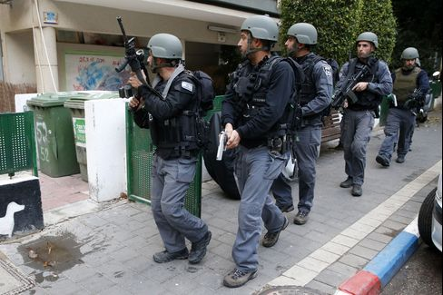 Israeli security forces search the area following the attack
