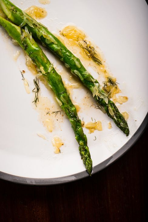 One of the simplest dishes is also one of the best: asparagus in brown butter, pomelo, and bronze fennel.