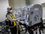 A health officer checks an isolation chamber at Juanda International Airport in Surabaya, East Java, on Jan. 30.