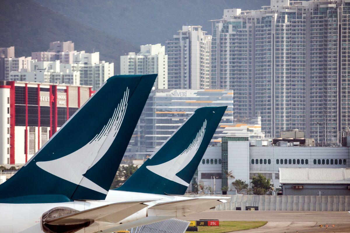 Cathay Cuts Earnings Outlook as Travelers Avoid Hong Kong