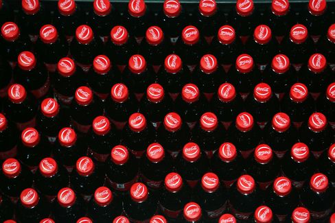 Bottles of Coca-Cola Move on a Production Line