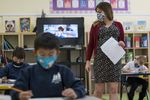 A teacher walks around the classroom during a lesson at an elementary school in San Francisco, on Oct. 5, 2020.