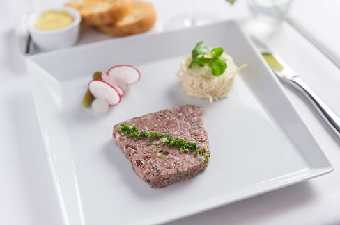 The rustic pork terrine made in house, with celery remoulade and cornichons.