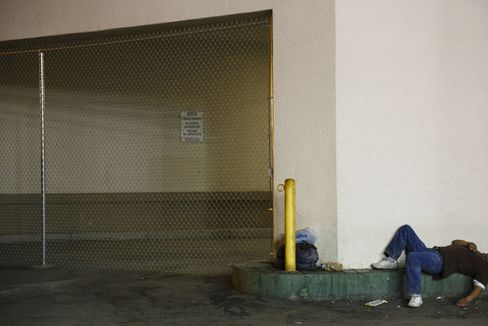 A man sleeps outside of a former Rabobank in Calexico