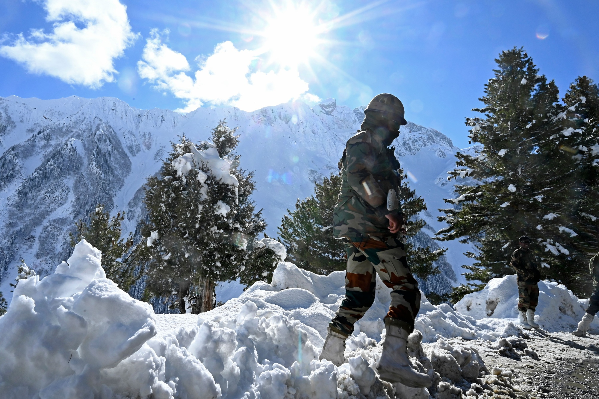 In November 2020, Indian soldiers stand near the Zojila mountain pass on the border with China.