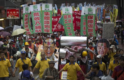Hong Kong Labor Day Protesters Back Dockers' Struggle Against Li