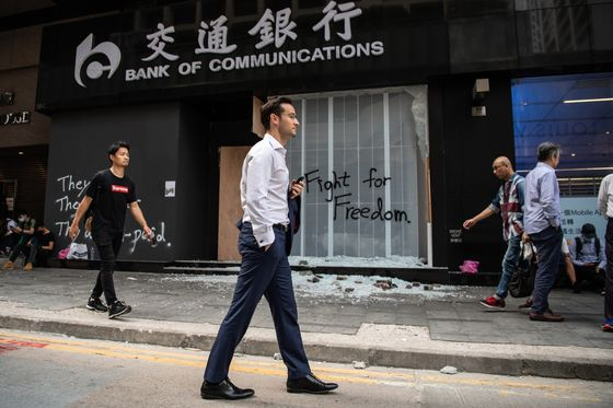 Hong Kong Bankers Say City's Divide Is Infecting Office Life