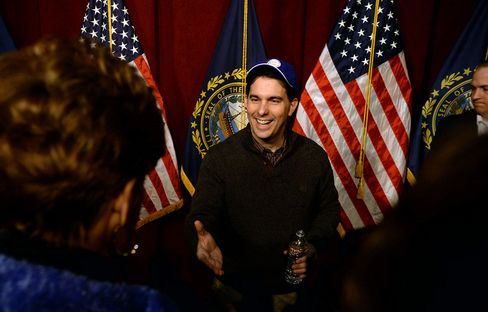 Wisconsin Governor Scott Walker shakes hands with people following a grassroots training and rally event at Concord High School on March 14, 2015.