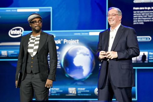 Will.i.am, left, with Paul Otellini, president and chief executive officer of Intel, during an event at CES 2012.