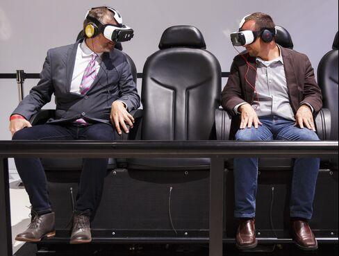 People wear Oculus Rift headsets