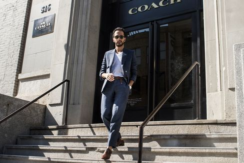 Moti attends the Coach presentation on the last day of shows in a roomier, linen suit by Born to Tailor, cotton v-neck T-shirt by Armani Exchange, and shoes by Louboutin.