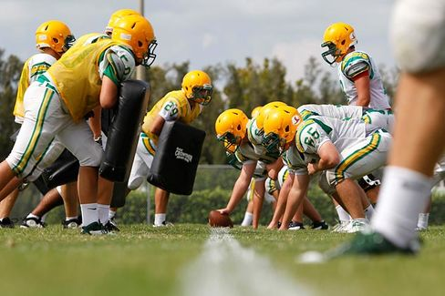Riddell Grapples With Football Helmet Woes
