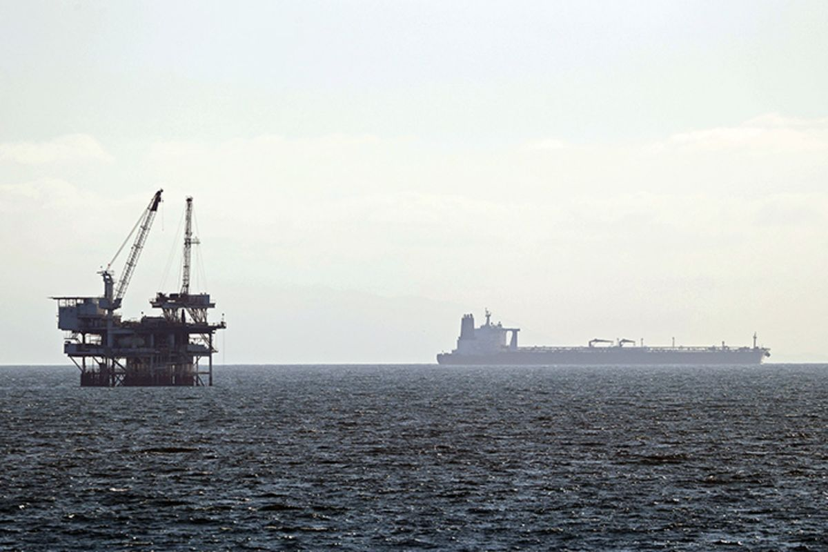 A tanker sits beyond an oil rig in Huntington Beach, California,on April 20.