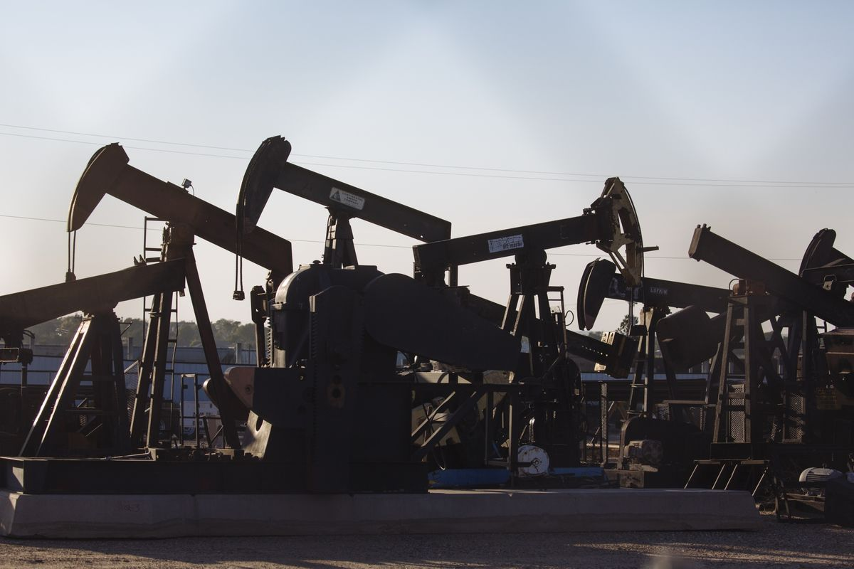 bloomberg.com - Kevin Crowley - Big Oil Pays for Past Bets on Fossil Fuels With $70 Billion Hit