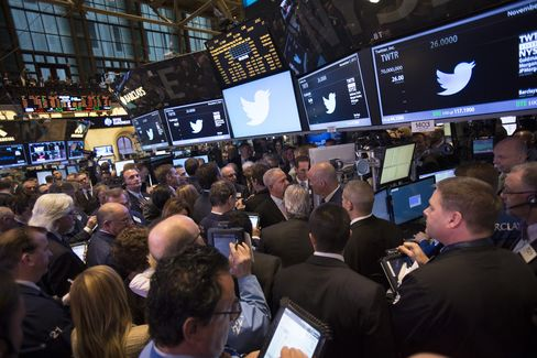 Traders Work at NYSE During Twitter's IPO Last Year