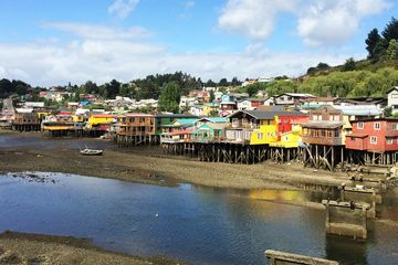 The stilted homes called palafitos of Chiloé's traditional fishing villages inspired the architecture of the hotel, which rises above the ground on concrete piles.