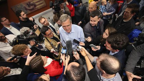 Jeb Bush speaks to reporters after an event at a Pizza Ranch restaurant on March 7, 2015, in Cedar Rapids, Iowa.