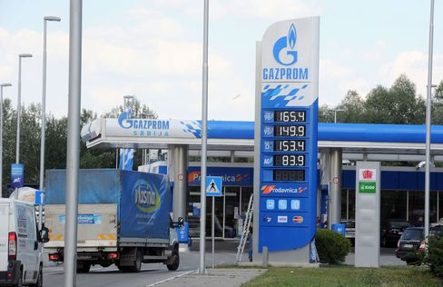 Gasoline prices sit on display outside a fuel station operated by OAO Gazprom Neft in Belgrade, Serbia, on June 5, 2014.