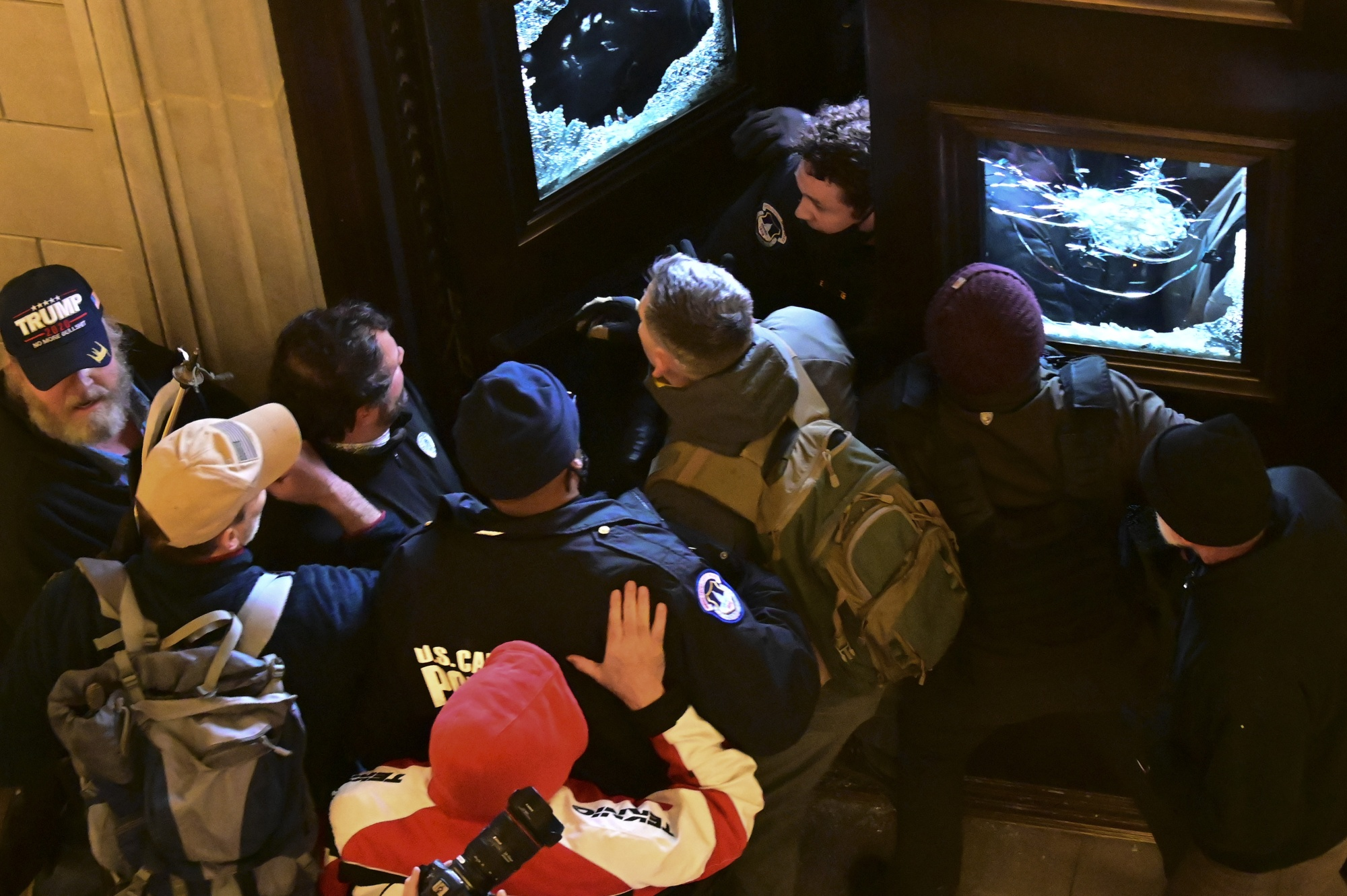 Demonstrators breach a door of the U.S. Capitol as a joint session of Congress to count the votes of the 2020 presidential election takes place in Washington, D.C., U.S., on Jan. 6.