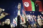 Libyans celebrate following the announcement of the liberation of the country in Martyr's Square,Tripoli, 2011.