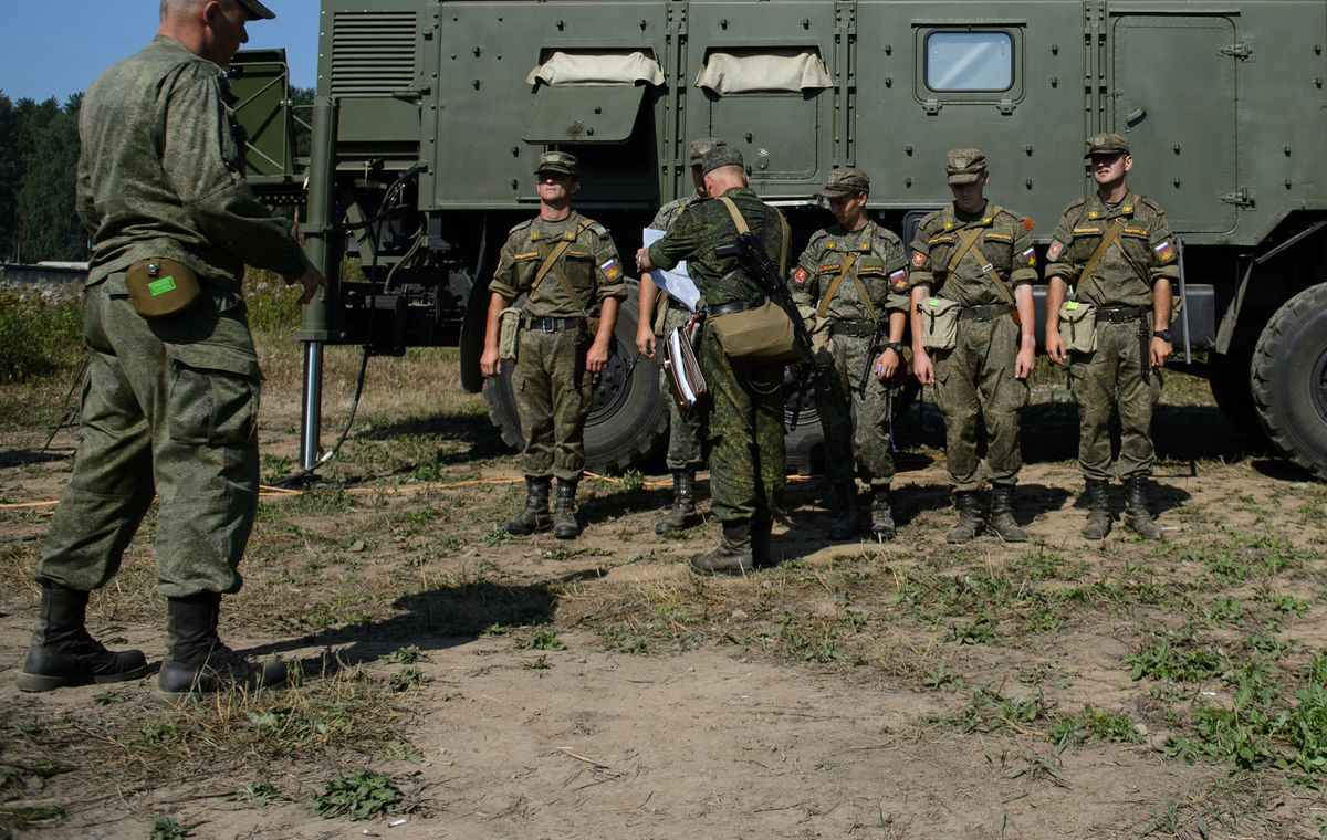 Putin Orders Army Drills as Merkel Accuses Russia on Ukraine