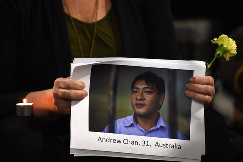 A Photo of Andrew Chan is Held at a Vigil in Sydney