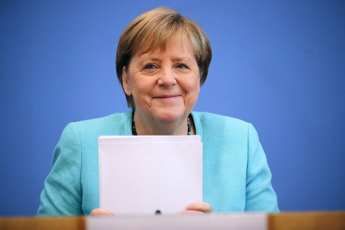 Merkel Charges Successor With Modernizing Germany's Economy