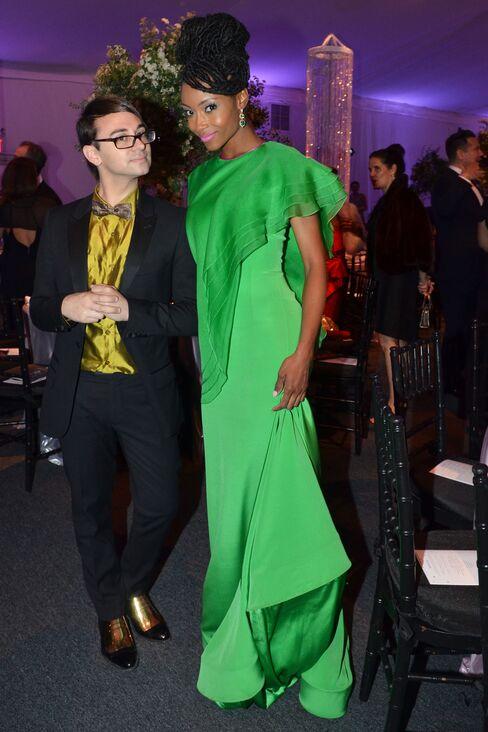 Designer Christian Siriano and Yaya DaCosta, an actress who played Whitney Houston in the biopic directed by Angela Bassett. Photographer: Amanda Gordon/Bloomberg