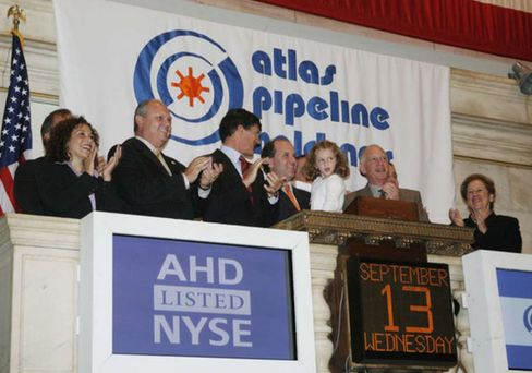 Ed Cohen, second right front, rings the opening bell in New York on Sept. 13, 2016.