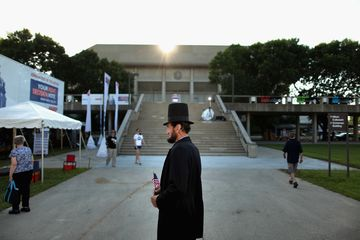 Stan DeHaan of Orange City, Iowa, plays the part of President Abraham Lincoln outside the Hilton Coliseum at Iowa State University in Ames, where people were preparing to vote in the Iowa Straw Poll on Aug. 13, 2011.