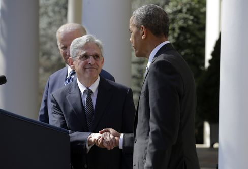 Merrick Garland, center, with Obama, right, and Biden.
