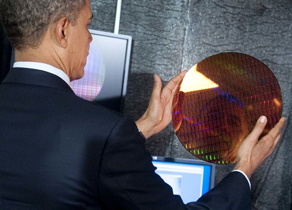 US President Barack Obama looks at his r