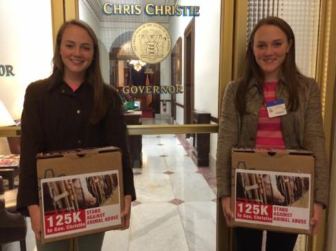Elizabeth and Abigail Fournier on Thursday dropped off their 125,000-signature petition at Christie's office.