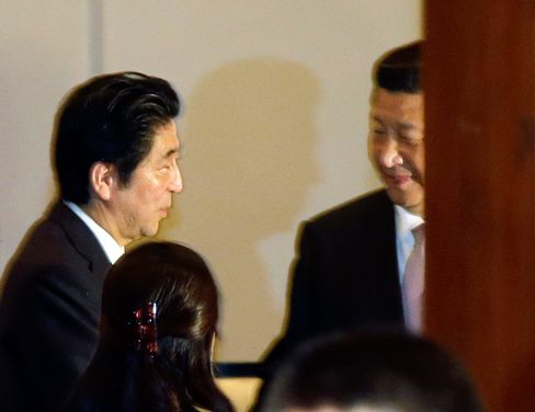 Japan's Prime Minister Shinzo Abe, left, talks with Chinese President Xi Jinping during their bilateral meeting on the sideline of the Asian African Summit in Jakarta, Indonesia on April 22, 2015.