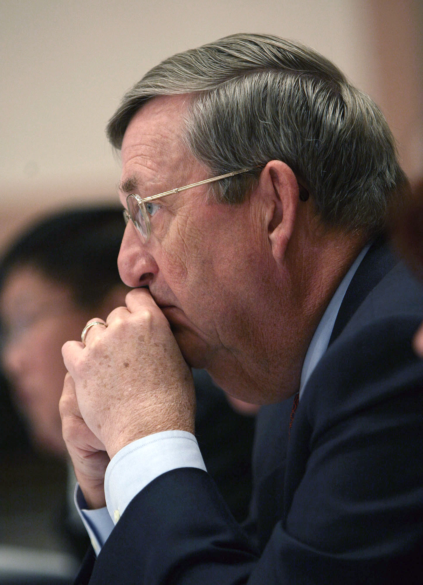Lee R. Raymond, then the chief executive of Exxon Mobil Corp., listens during testimony at the President's Export Council in 2005.