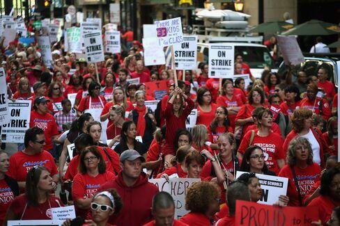 Obama Caught Between Schools Overhaul, Striking Union Supporters