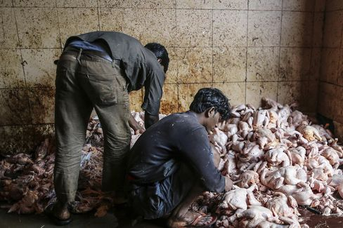 Butchers prepare chicken meat at Crawford market in Mumbai. Chicken consumption in India is now 14 times higher than in 1985.