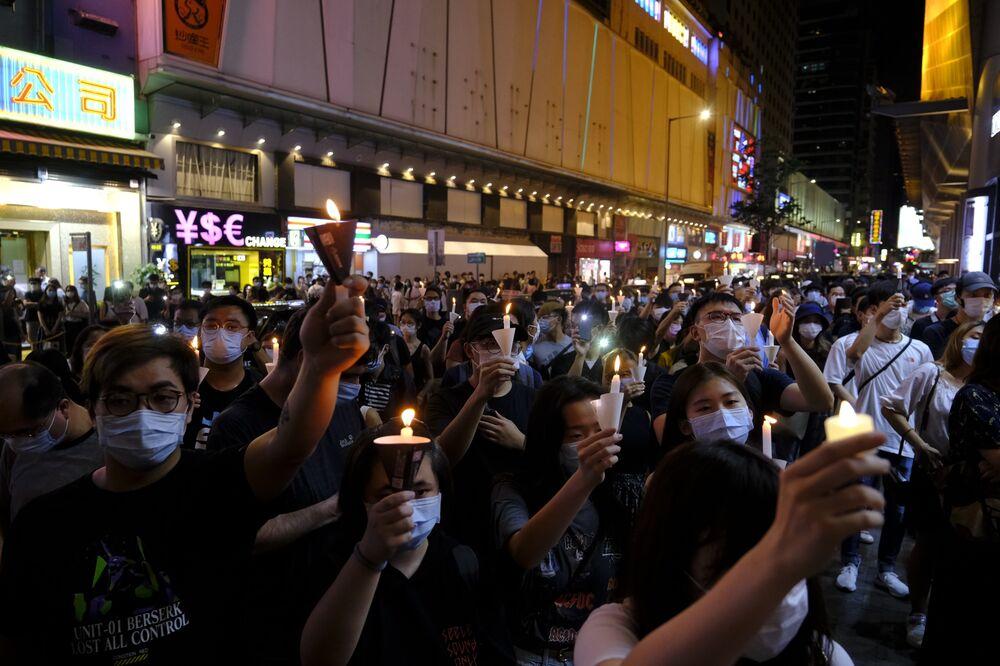 Người dân Hồng Kông tụ tập để kỷ niệm 31 năm cuộc đàn áp Thiên An Môn, tại Hồng Kông vào ngày 4 tháng 6. Nhiếp ảnh gia: Roy Liu / Bloomberg