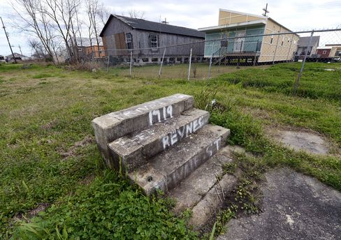 Stairs lead to a vacant lot in the Lower Ninth Ward of New Orleans in 2013.