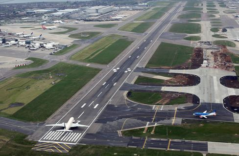 Aircraft Sit On The Runway At Heathrow Airport