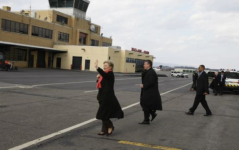 Hillary Clinton walks from her airplane across the tarmac to meet supporters at Wilkes-Barre Scranton Airport in Scranton, Pennsylvania, on March 10, 2008.