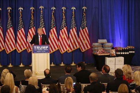 Donald Trump speaks alongside branded steaks, water bottles and wine in Jupiter, Florida, on March 8.