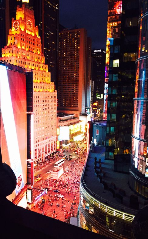 Times Square's Broadway, by night, as seen from the St. Cloud rooftop at the Knickerbocker Hotel.