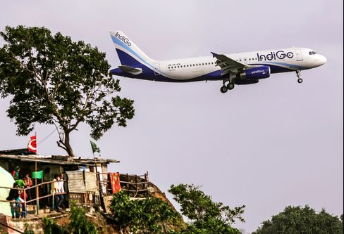 An Airbus A320 operated by IndiGo approaches Chhatrapati Shivaji International Airport in Mumbai.